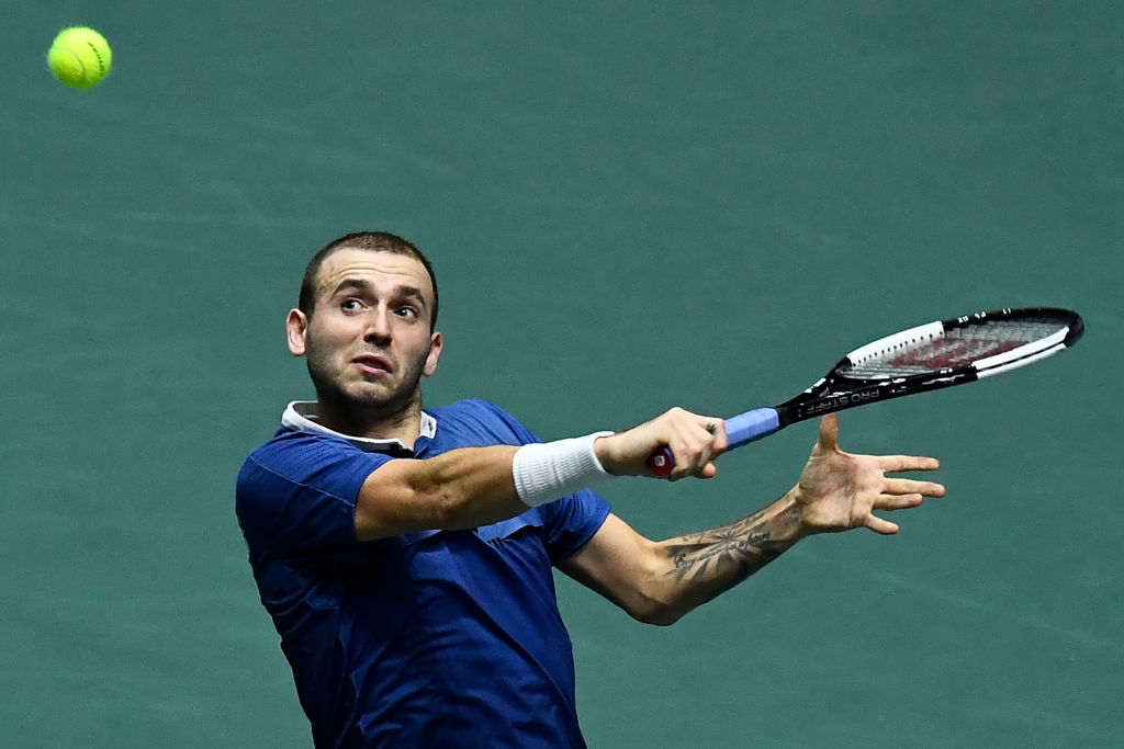 Dan Evans plays for Great Britain at the 2019 Davis Cup finals
