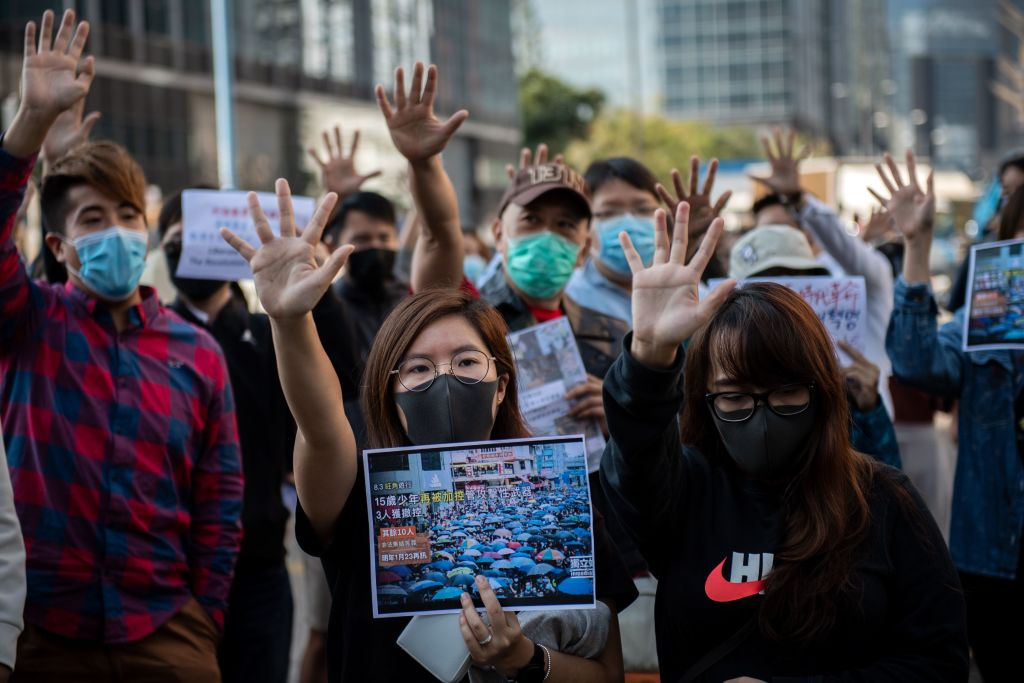 People gather in support of pro-democracy protesters during a lunch break rally in the Kwun Tong area in Hong Kong