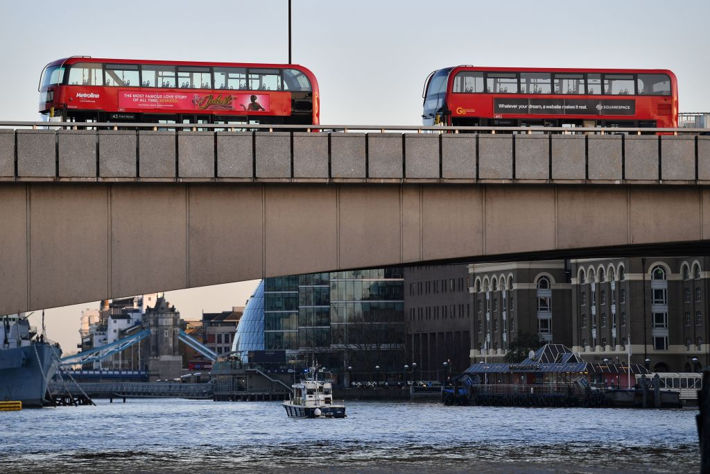 Buses are pictured on London Bridge after reports of shots being fired