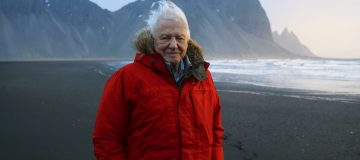 Programme Name: Seven Worlds, One Planet - TX: n/a - Episode: n/a (No. n/a) - Picture Shows: Sir David Attenborough filming at Stokksnes beach in Iceland for Seven Worlds, One Planet. Social Media Use Unless specified to the contrary below, it is permitted to post the image on social network sites such as Facebook provided they are reduced to 72dpi and no more than 720 x 491 pixels in size and the programme title and full copyright credit. Sir David Attenborough - (C) BBC NHU - Photographer: Alex Board