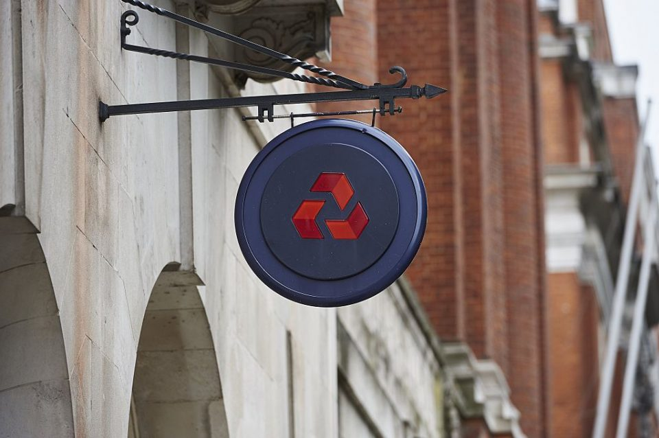 Natwest down: Natwest logo hangs on shingle outside a branch of the bank