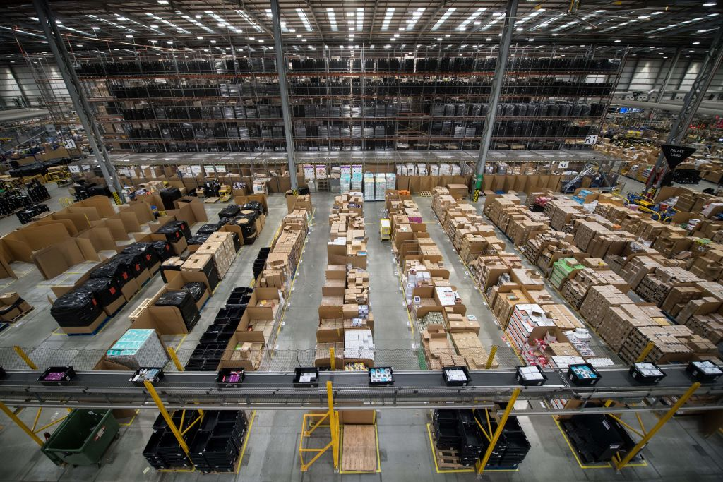 Workers prepare customer orders for Black Friday in an Amazon fulfillment centre in Peterborough