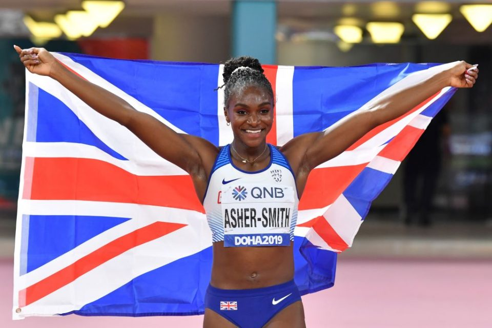 Britain's Dina Asher-Smith celebrates after winning the Women's 200m final at the 2019 IAAF Athletics World Championships at the Khalifa International stadium in Doha on October 2, 2019. (Photo by ANDREJ ISAKOVIC / AFP) (Photo by ANDREJ ISAKOVIC/AFP via Getty Images)