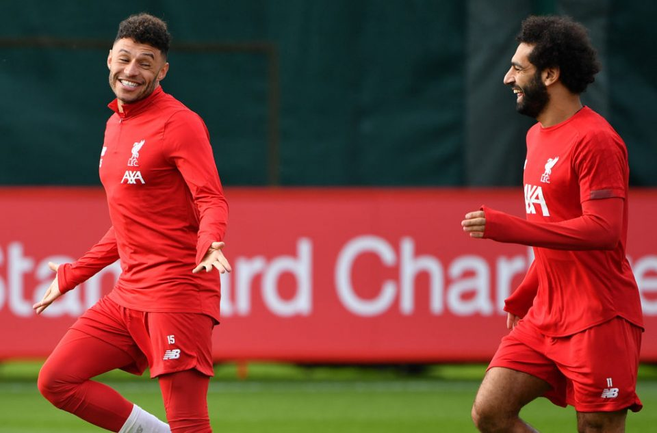 Liverpool's English midfielder Alex Oxlade-Chamberlain (L) and Liverpool's Egyptian midfielder Mohamed Salah react during a team training session at Melwood in Liverpool, north west England on October 22, 2019, on the eve of their UEFA Champions League Group E football match against Genk. (Photo by Paul ELLIS / AFP) (Photo by PAUL ELLIS/AFP via Getty Images)
