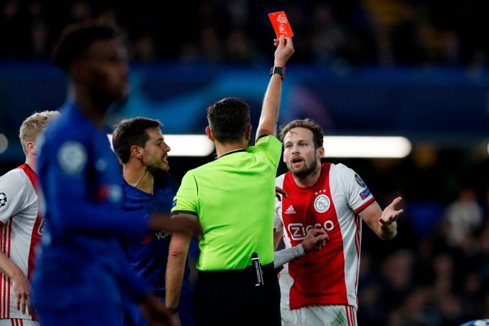 Ajax's Dutch defender Daley Blind (R) reacts as he is shown a red card by Italian referee Gianluca Rocchi during the UEFA Champion's League Group H football match between Chelsea and Ajax at Stamford Bridge in London on November 5, 2019. (Photo by Adrian DENNIS / AFP) (Photo by ADRIAN DENNIS/AFP via Getty Images)