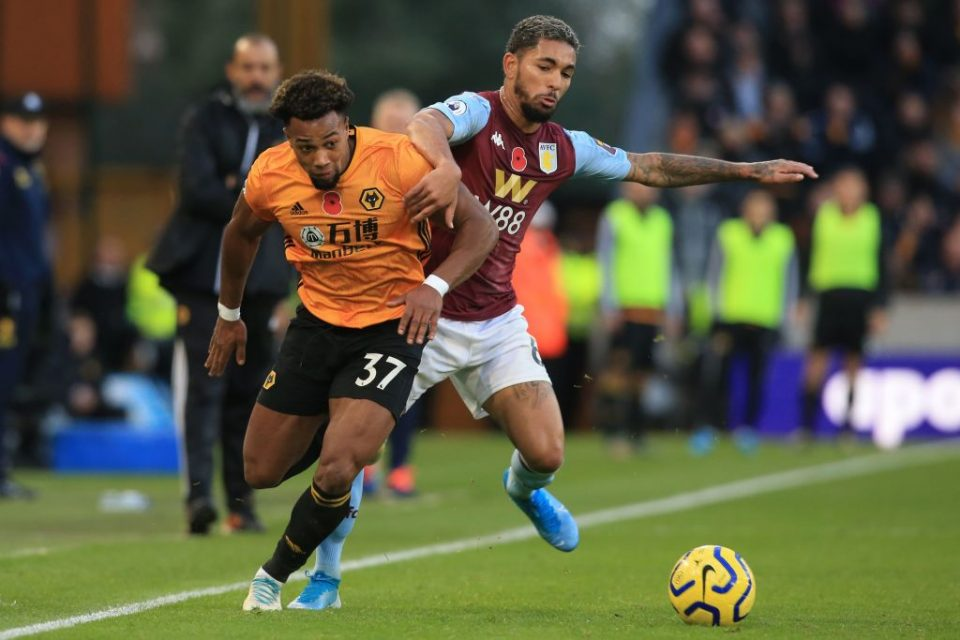 Wolverhampton Wanderers' Spanish striker Adama Traore (L) vies with Aston Villa's Brazilian midfielder Douglas Luiz (R) during the English Premier League football match between Wolverhampton Wanderers and Aston Villa at the Molineux stadium in Wolverhampton, central England  on November 10, 2019. - Wolves won the game 2-1. (Photo by Lindsey Parnaby / AFP) / RESTRICTED TO EDITORIAL USE. No use with unauthorized audio, video, data, fixture lists, club/league logos or 'live' services. Online in-match use limited to 120 images. An additional 40 images may be used in extra time. No video emulation. Social media in-match use limited to 120 images. An additional 40 images may be used in extra time. No use in betting publications, games or single club/league/player publications. /  (Photo by LINDSEY PARNABY/AFP via Getty Images)
