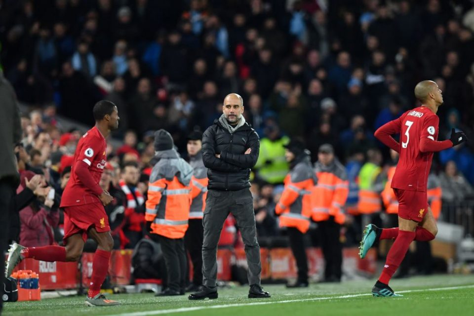 Manchester City's Spanish manager Pep Guardiola (C) watches the Liverpool team run out at the start of the second half during the English Premier League football match between Liverpool and Manchester City at Anfield in Liverpool, north west England on November 10, 2019. (Photo by Paul ELLIS / AFP) / RESTRICTED TO EDITORIAL USE. No use with unauthorized audio, video, data, fixture lists, club/league logos or 'live' services. Online in-match use limited to 120 images. An additional 40 images may be used in extra time. No video emulation. Social media in-match use limited to 120 images. An additional 40 images may be used in extra time. No use in betting publications, games or single club/league/player publications. /  (Photo by PAUL ELLIS/AFP via Getty Images)