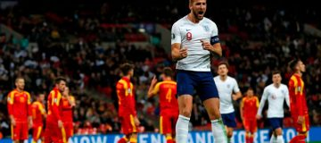 England's striker Harry Kane (C) celebrates after scoring their third goal during the UEFA Euro 2020 qualifying first round Group A football match between England and Montenegro at Wembley Stadium in London on November 14, 2019. (Photo by Adrian DENNIS / AFP) / NOT FOR MARKETING OR ADVERTISING USE / RESTRICTED TO EDITORIAL USE (Photo by ADRIAN DENNIS/AFP via Getty Images)