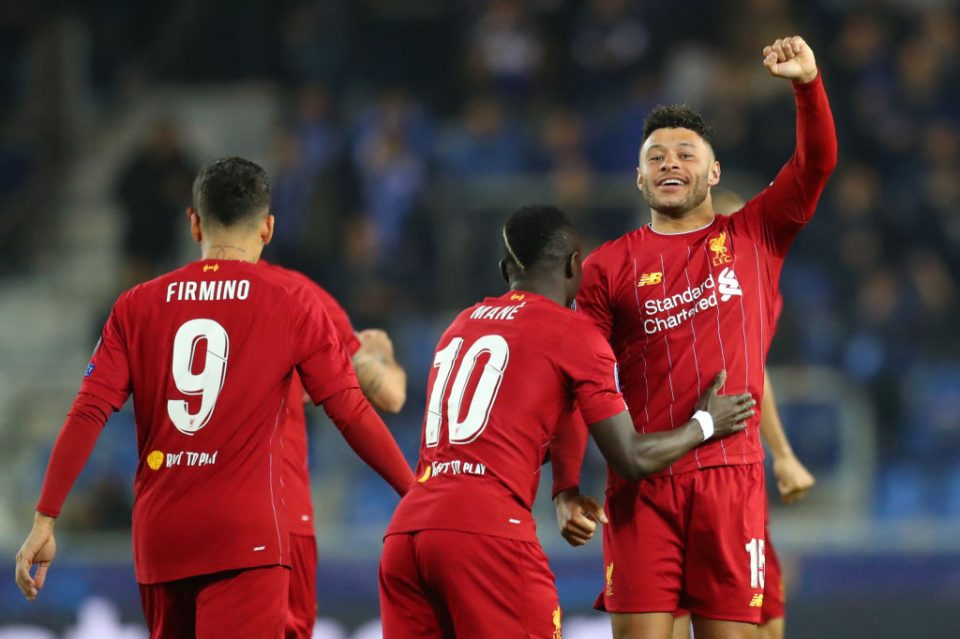 GENK, BELGIUM - OCTOBER 23: Alex Oxlade-Chamberlain of Liverpool celebrates with teammate Sadio Mane after scoring his team's first goal during the UEFA Champions League group E match between KRC Genk and Liverpool FC at Luminus Arena on October 23, 2019 in Genk, Belgium. (Photo by Catherine Ivill/Getty Images)