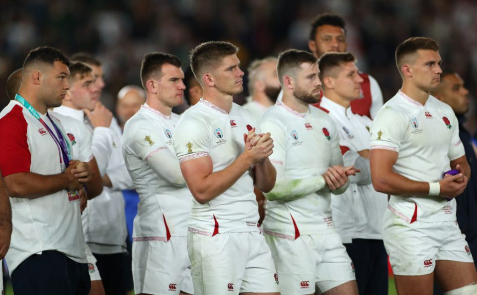 YOKOHAMA, JAPAN - NOVEMBER 02: England captain Owen Farrell (c) and team mates look on dejectedly as South Africa receive the winners trophy after the Rugby World Cup 2019 Final between England and South Africa at International Stadium Yokohama on November 02, 2019 in Yokohama, Kanagawa, Japan. (Photo by Stu Forster/Getty Images)