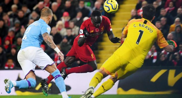 LIVERPOOL, ENGLAND - NOVEMBER 10: Sadio Mane of Liverpool scores his team's third goal during the Premier League match between Liverpool FC and Manchester City at Anfield on November 10, 2019 in Liverpool, United Kingdom. (Photo by Laurence Griffiths/Getty Images)