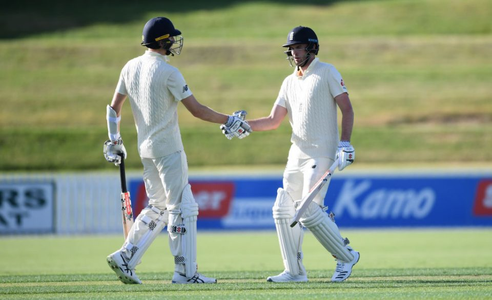 WHANGAREI, NEW ZEALAND - NOVEMBER 12: Dom Sibley of England celebrates with Zak Crawley after reaching his century during the tour match between New Zealand XI and England at Cobham Oval on November 12, 2019 in Whangarei, New Zealand. (Photo by Gareth Copley/Getty Images)