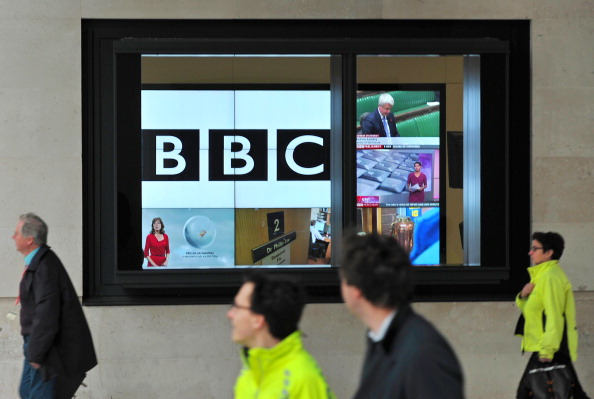 A BBC logo is pictured on a television screen inside the BBC's New Broadcasting House office in central London, on November 12, 2012. The BBC announced that two of its executives were standing aside on Monday and warned more heads may roll as it battles with a major crisis over its reporting of sex abuse that toppled the director-general. AFP PHOTO / CARL COURT (Photo credit should read CARL COURT/AFP via Getty Images)