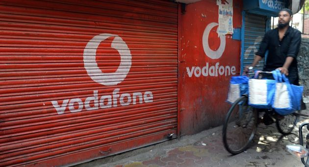 Vodafone threatens to ditch India amid dispute over taxes