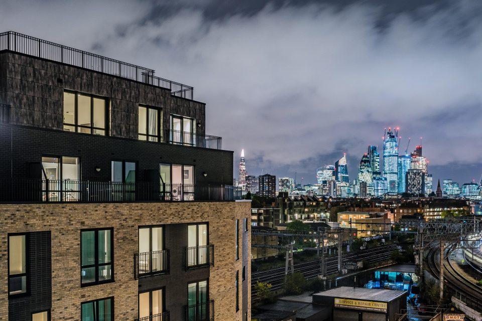 The Dressage Court apartment block in Bethnal Green, with the London skyline in the background