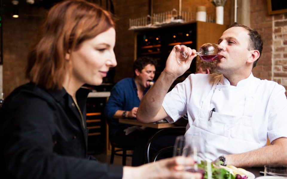 James Lowe enjoys a glass of wine with Alice Levine