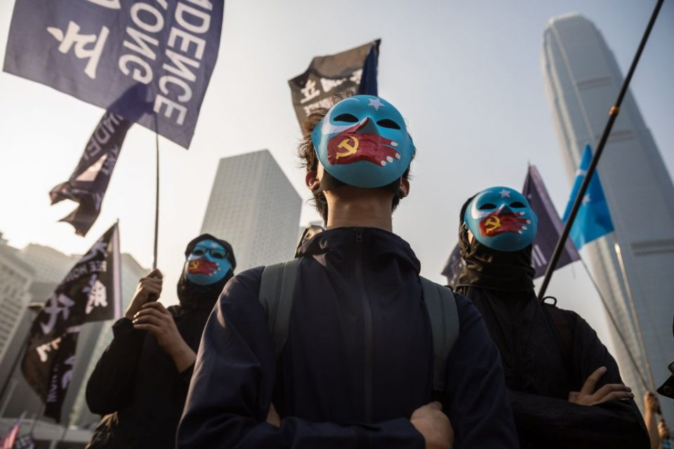 Protesters attend a rally in Hong Kong on Sunday