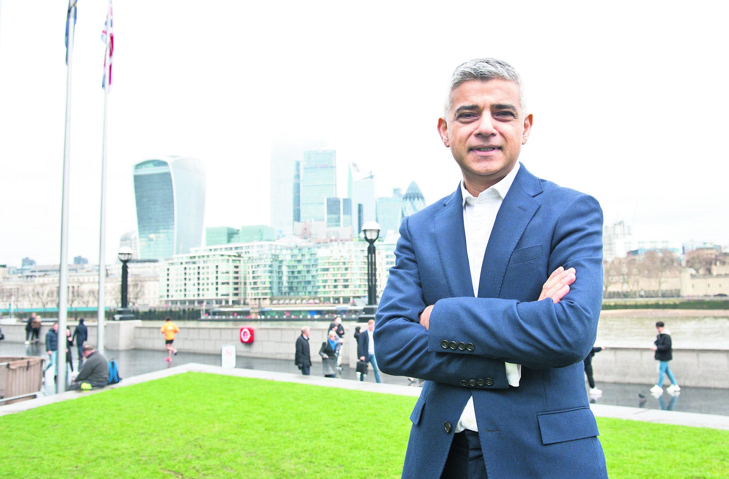 London mayor Sadiq Khan in front of the City of London skyline