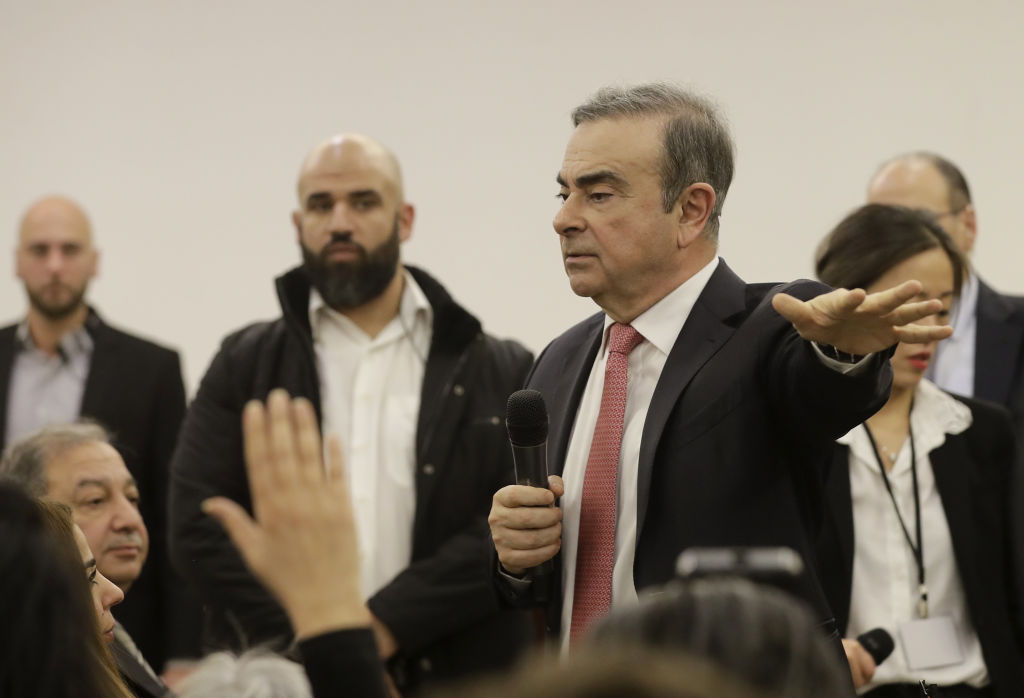 Ghosn answers journalists' questions (Getty)
