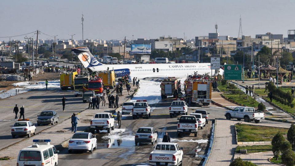 Iran plane skids onto major highway after pilot misses runway