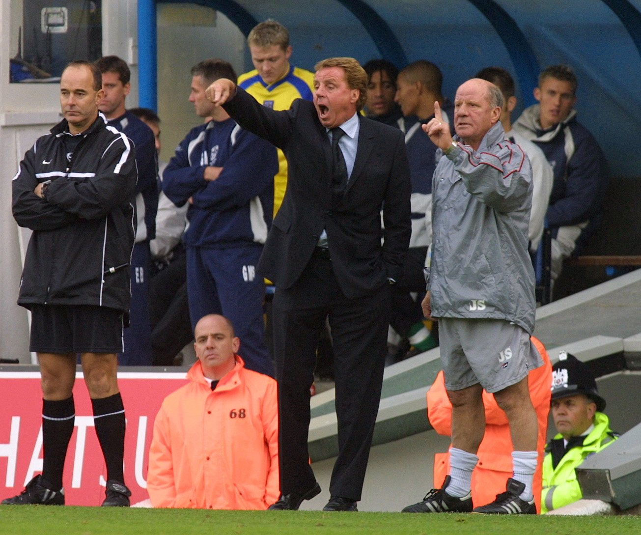 Portsmouth manager Harry Redknapp [C] and Assistant manager Jim Smith (R) shout orders from the touchline