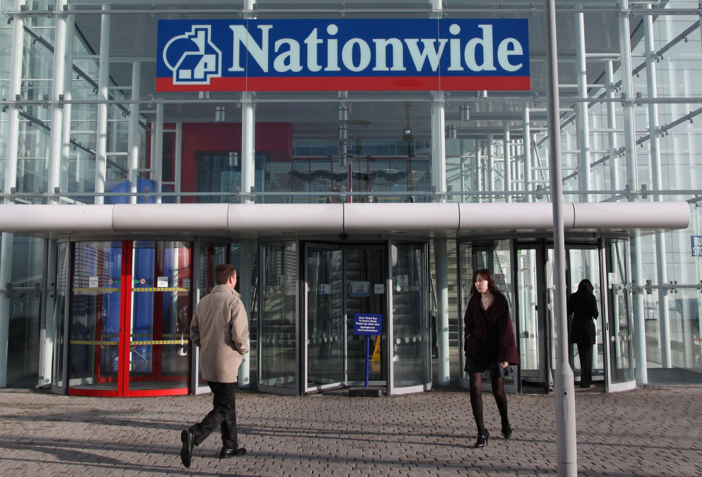 Building society Nationwide's annual profit nearly halved it said today as it warned of rising loan losses due to the coronavirus pandemic.