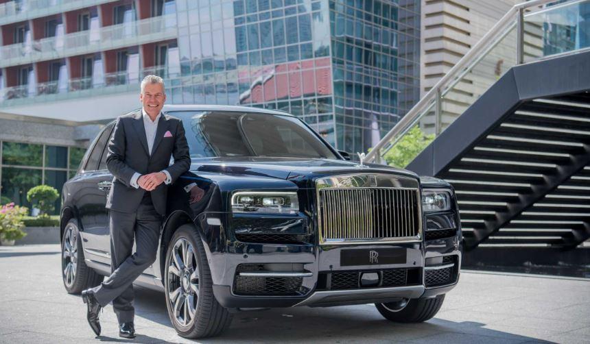 Rolls Royce CEO Torsten Muller-Otvos with Cullinan by Rolls-Royce