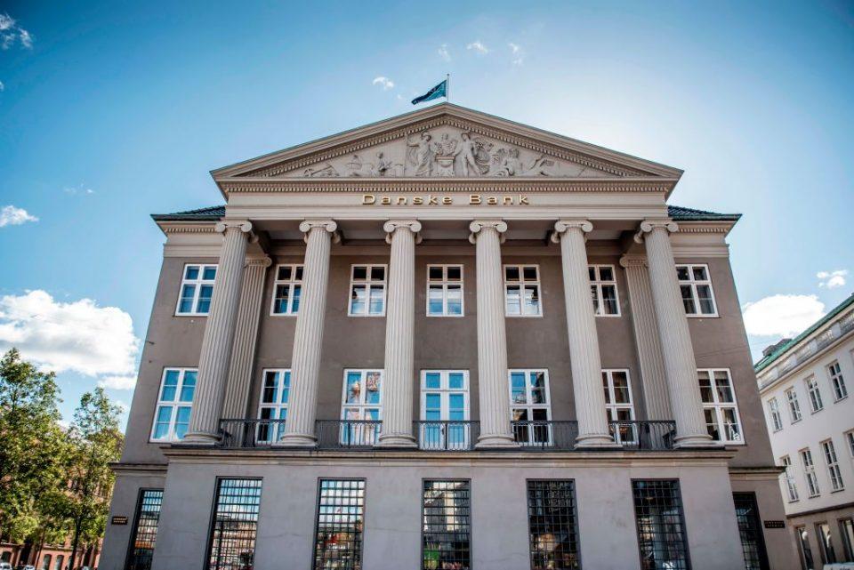 Danske Bank warns profit could almost halve this year