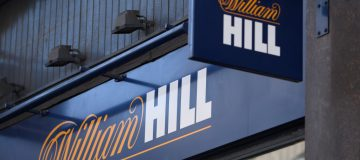 Bookmaker William Hill's shares rose this morning on hopes that the return of Bundesliga football in Germany and horse racing will help it emerge from the crisis.