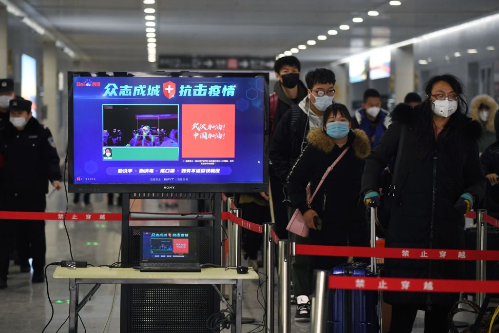 Covid-19: Coronavirus checks installed at a Beijing railway stations to test passengers for fevers