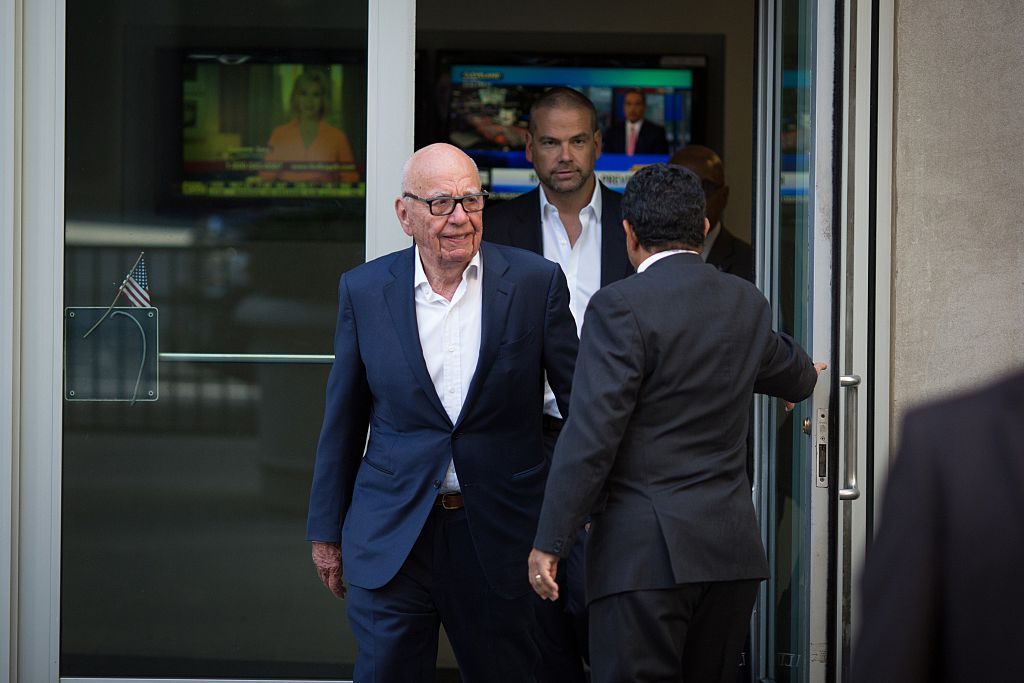 Murdoch empire hit by phone hacking charges as Sun suffers hefty loss
