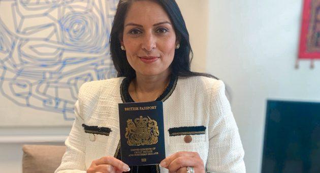 Priti Patel holds one of Britain's new blue passports