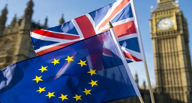 European Union and British Union Jack flag flying in front of Big Ben and the Houses of Parliament at Westminster Palace, London, in symbol of the Brexit EU referendum