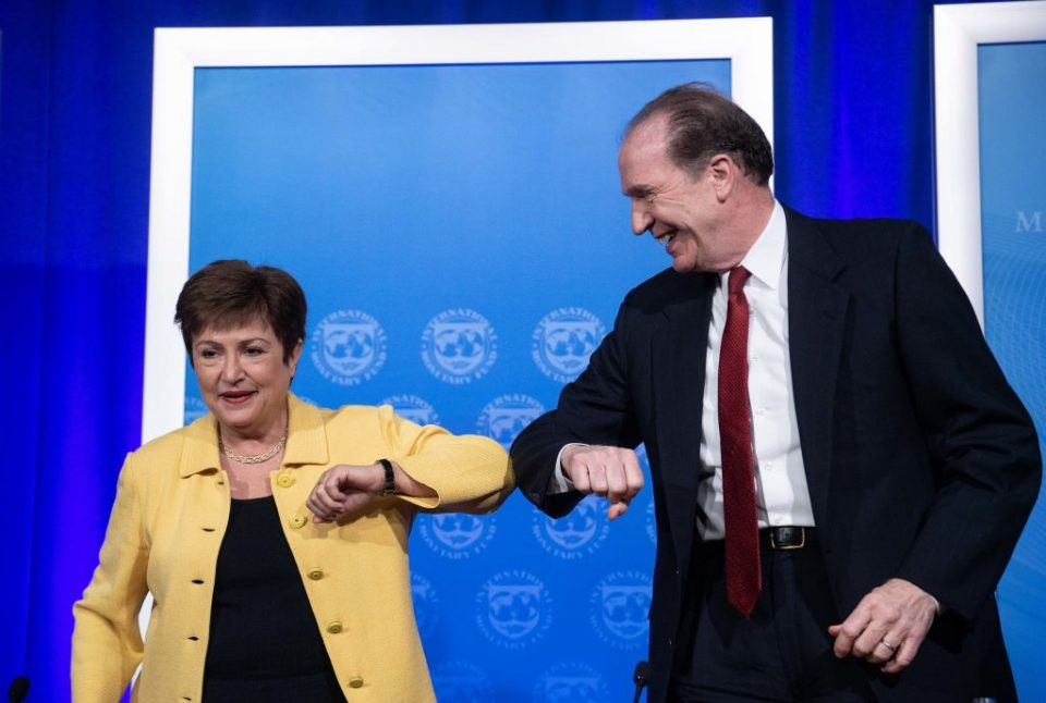 IMF Managing Director Kristalina Georgieva and World Bank Group President David Malpass bump elbows at the end of a joint press briefing on COVID-19 in Washington, DC, on March 4, 2020.