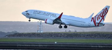 Embattled Virgin Australia has said it will ground all domestic flights except a single daily trip from Sydney to Melbourne due to coronavirus, and is seeking AU$1.4bn (£707m) in government aid.