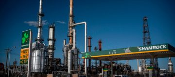 Global oil prices eased their rally this morning but remained on track for a huge weekly loss after unprecedented levels of volatility left producers and traders alike bruised.