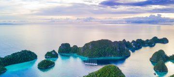 Exploring the pristine ocean of Raja Ampat on a private catamaran expedition