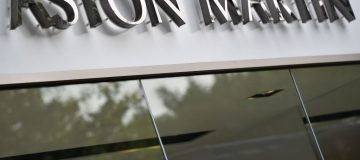 One of Aston Martin's largest shareholders has trimmed its stake in the iconic British carmaker by five per cent, a regulatory filing showed today.