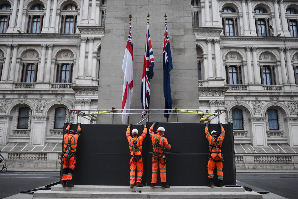 Workers erect a protective barrier around the Cenotaph in anticipation of London protests, with anti-racist protesters and far-right protesters set to clash
