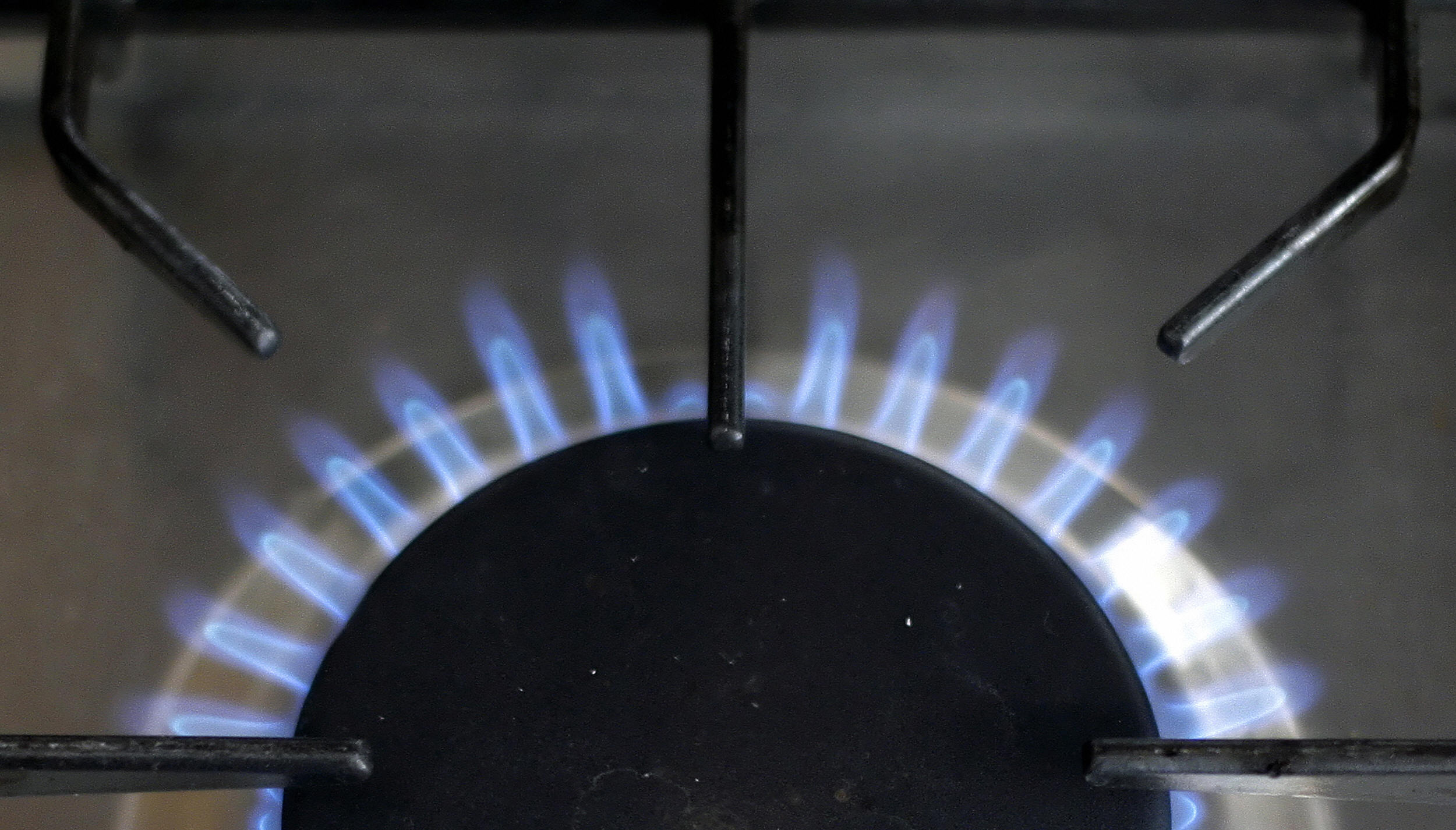 A gas burner of a stove is pictured in L