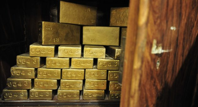 Gold hits record $1,980 high as dollar weakens