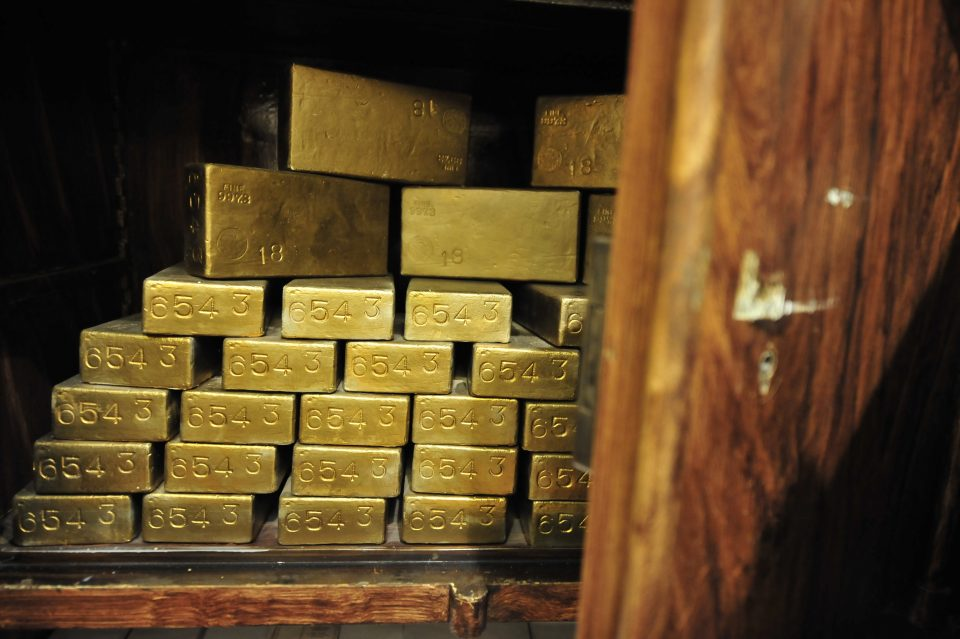 Gold hurtled to record peaks today before the sheer scale of its gains drew a burst of profit taking, which in turn helped the dollar up from two-year lows.