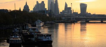 FTSE 100 opens flat as investors weigh earnings and coronavirus cases