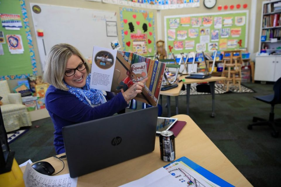 Teacher Instructs Remotely From Empty Classroom
