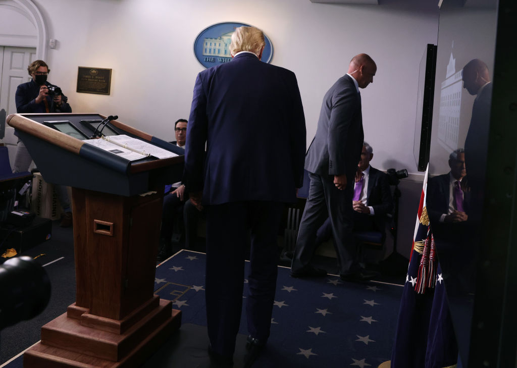 A Secret Service agent tells President Donald Trump to leave the briefing room after a shooting near the White House