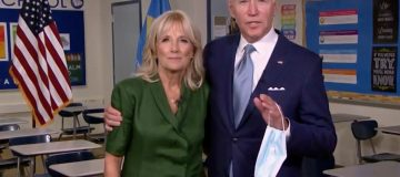 Democratic presidential nominee former Vice President Joe Biden holds a mask in his hand as he joins Former U.S. Second Lady Dr. Jill Biden in a classroom after she addressed the virtual convention on August 18, 2020
