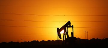 Global oil prices hit their highest levels in five months today after a larger than expected decline in US crude inventories offset fears of a slowdown in fuel demand.