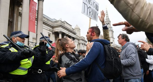 Covid-19: Protesters clash with police at anti-restrictions rally in London