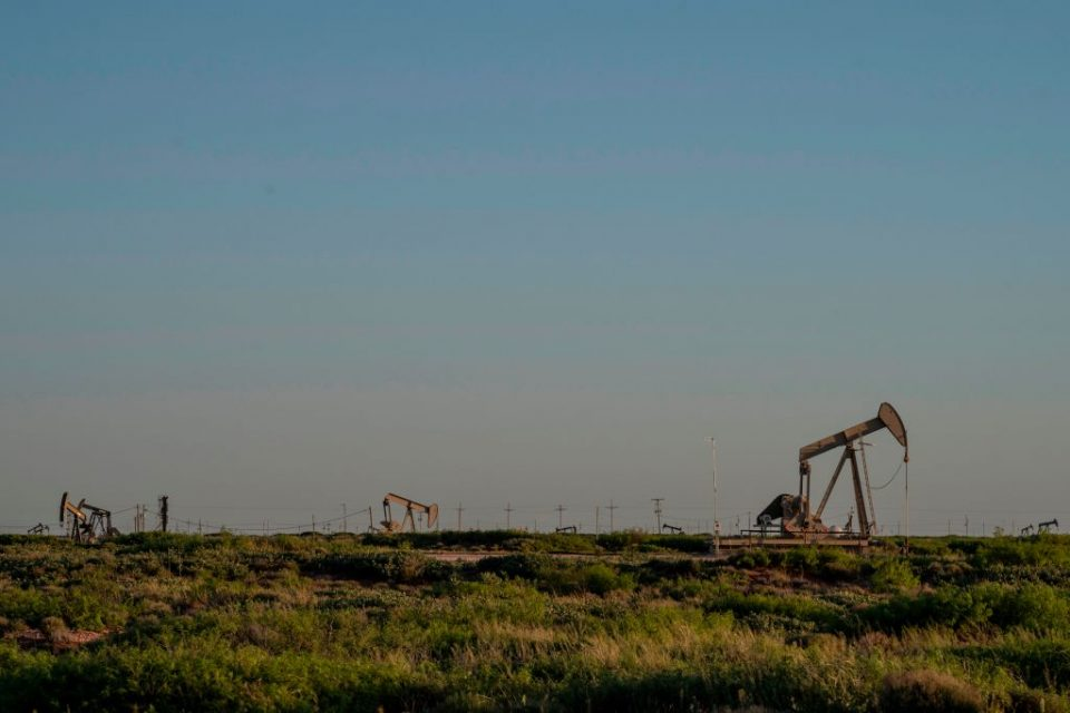 Global oil prices dropped sharply this morning amid fears of a ramp in production even as governments implement more stringent restrictions to cope with a surge in coronavirus cases.