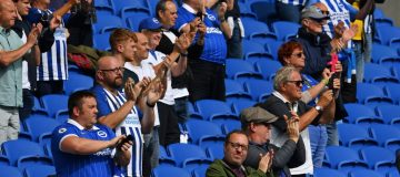 Socially-distanced supporters watch Brighton play Chelsea in a pre-season friendly